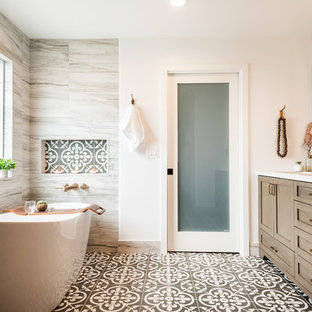 Example of a beach style master multicolored tile multicolored floor freestanding bathtub design in Los Angeles with shaker cabinets, medium tone wood cabinets, white walls and white countertops
