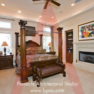Ejemplo de dormitorio principal y abovedado, mediterráneo, extra grande, con paredes beige, suelo de madera en tonos medios, chimenea tradicional, marco de chimenea de hormigón y suelo marrón