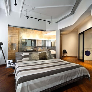 Inspiration for a contemporary medium tone wood floor bedroom remodel in Singapore with white walls