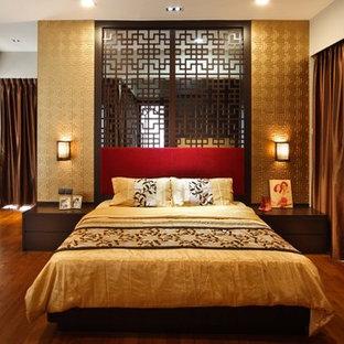 Esempio di una camera da letto etnica con pareti grigie