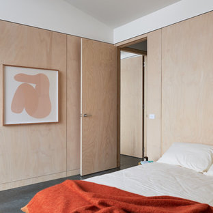 Photo of a contemporary guest bedroom in Melbourne with beige walls, concrete floors and grey floor.