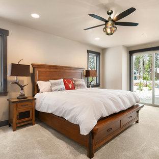 Inspiration for a rustic carpeted and beige floor bedroom remodel in Seattle with white walls