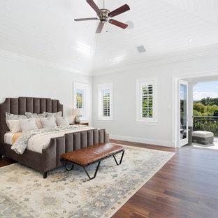 Bon Bedroom   Tropical Dark Wood Floor And Brown Floor Bedroom Idea In Miami  With Gray Walls