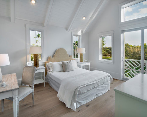 Inspiration For A Beach Style Light Wood Floor And Beige Floor Bedroom  Remodel In Other With