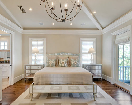 mid sized beach style master medium tone wood floor bedroom idea in miami with beige - Mirrored Bed Frame
