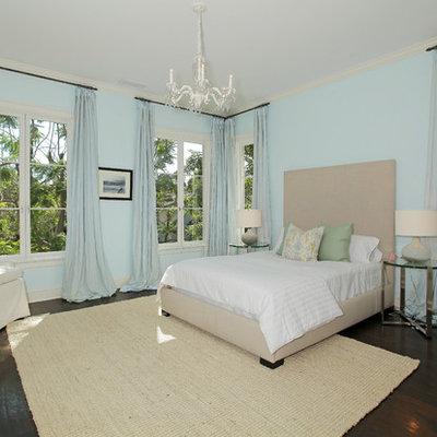 Example of a classic dark wood floor bedroom design in Los Angeles with blue walls