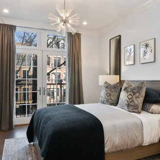 Example of a transitional dark wood floor and brown floor bedroom design in Chicago with gray walls
