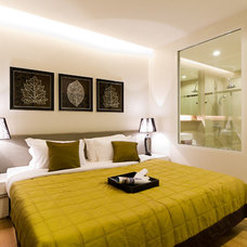 Contemporary Bedroom by Nitsumon Dummananda