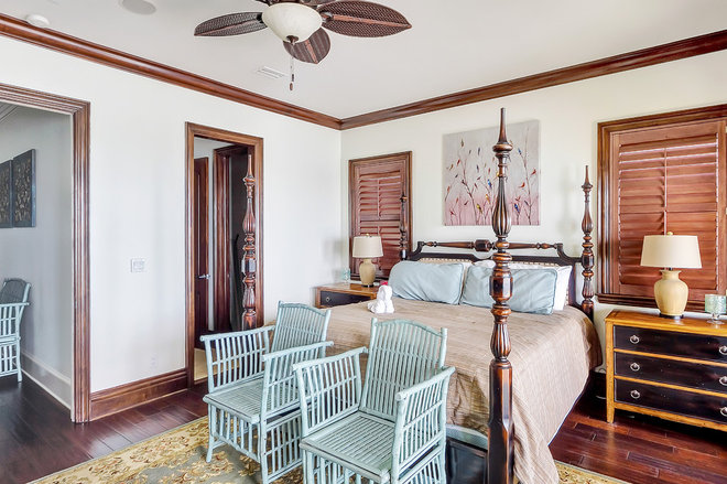 Tropical Bedroom by Emerald Coast Real Estate Photography