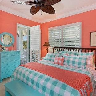 Imagen de dormitorio principal, marinero, de tamaño medio, con paredes azules, moqueta, chimenea de esquina, marco de chimenea de hormigón y suelo beige
