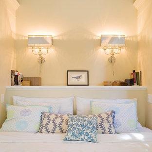 Elegant bedroom photo in San Francisco with yellow walls