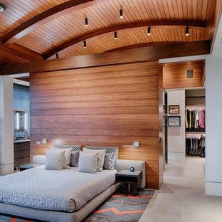 Modelo de dormitorio contemporáneo con paredes blancas y suelo gris