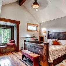 Rustic Bedroom by Pinnacle Mountain Homes