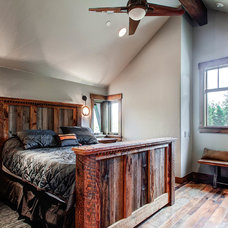 Rustic Bedroom by Pinnacle Mountain Homes
