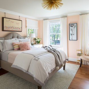 Mid-sized transitional medium tone wood floor bedroom photo in St Louis with pink walls