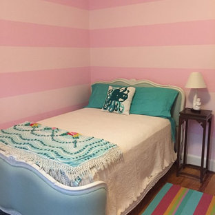 Medium sized nautical guest bedroom in Tampa with pink walls and light hardwood flooring.