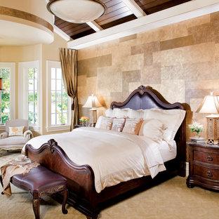 Bedroom - huge mediterranean master carpeted bedroom idea in Indianapolis with beige walls