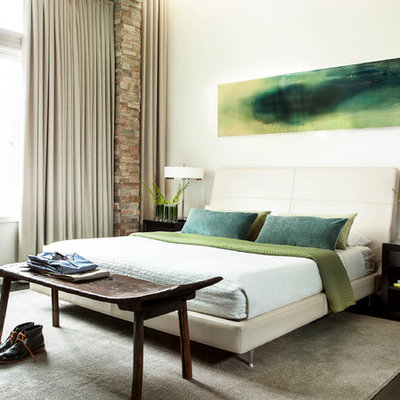 Inspiration for a contemporary dark wood floor bedroom remodel in Atlanta with white walls