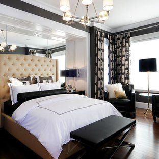This is an example of a contemporary master bedroom in Other with black walls, dark hardwood flooring and no fireplace.