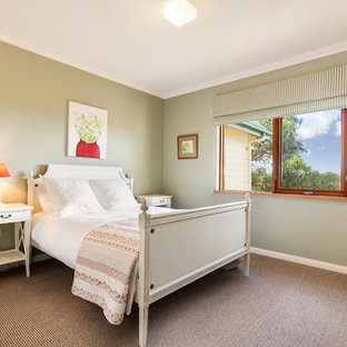 Design ideas for a traditional guest bedroom in Melbourne with green walls, carpet and brown floor.