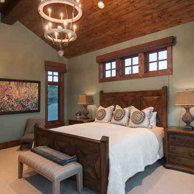 Example of a mountain style carpeted bedroom design in Salt Lake City with gray walls