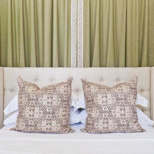 Small transitional guest bedroom in Atlanta with beige walls, medium hardwood floors and orange floor.