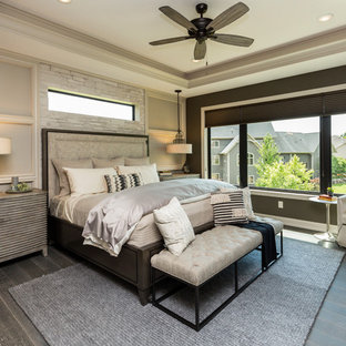 Large transitional master bedroom in Other with brown walls, porcelain floors, no fireplace and brown floor.