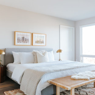 Inspiration for a small contemporary medium tone wood floor and brown floor bedroom remodel in San Francisco with beige walls