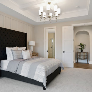 Photo of a transitional master bedroom in Minneapolis with beige walls, carpet, no fireplace, grey floor, coffered and panelled walls.
