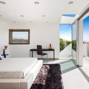 Inspiration for a contemporary bedroom remodel in Los Angeles with white walls