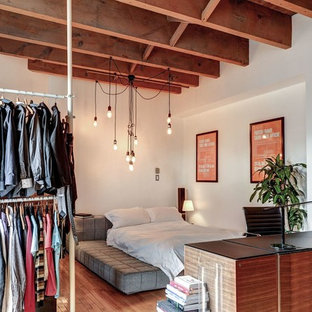 Photo of a small industrial loft-style bedroom in Montreal.