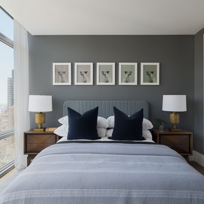 Bedroom - contemporary light wood floor bedroom idea in New York with gray walls and no fireplace