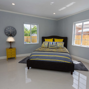 Mid Sized Trendy Master Linoleum Floor And Beige Bedroom Photo In Miami With Blue