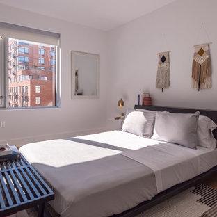 Trendy Guest Medium Tone Wood Floor And Brown Floor Bedroom Photo In New  York With White