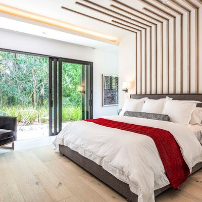 Bedroom - contemporary master light wood floor and beige floor bedroom idea in Orlando with white walls