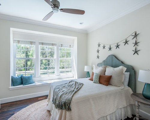 beach style bedroom idea in miami with beige walls - Beach Themed Bedrooms