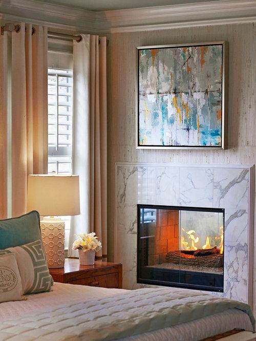 Camera degli ospiti con camino bifacciale foto e idee for Arredare camera ospiti