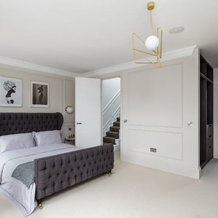 Photo of a medium sized classic bedroom in London with grey walls, carpet and beige floors.