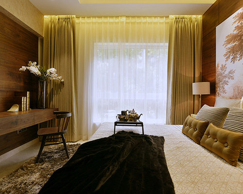 inspiration for a small contemporary master bedroom remodel in mumbai with white walls
