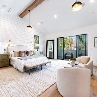 Идея дизайна: спальня в стиле кантри с белыми стенами, паркетным полом среднего тона, горизонтальным камином, фасадом камина из плитки и коричневым полом