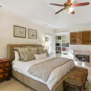 Example of a large classic master carpeted and beige floor bedroom design in Charleston with beige walls, a standard fireplace and a tile fireplace