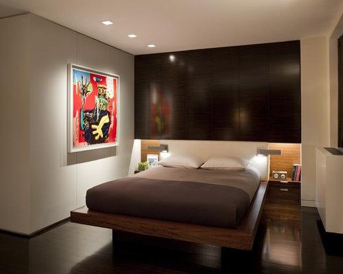 Modern Dark Wood Floor Bedroom Idea In New York With Beige Walls