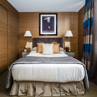 Inspiration for a transitional carpeted and green floor bedroom remodel in New York with brown walls