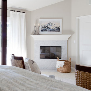 Inspiration for a large traditional master bedroom in Los Angeles with carpet, a corner fireplace and a stone fireplace surround.