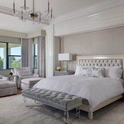 Bedroom - transitional master light wood floor bedroom idea in Other with beige walls and no fireplace