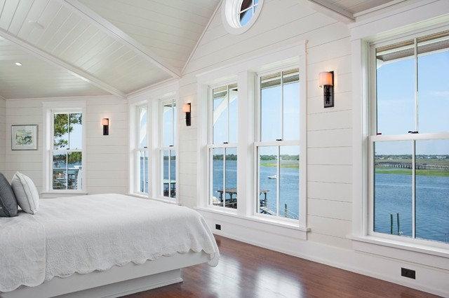 Tropical Bedroom by Brown Contractors Fine Custom Homes