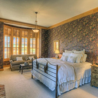 Mid-sized country guest bedroom in Seattle with multi-coloured walls, carpet, a standard fireplace and a wood fireplace surround.