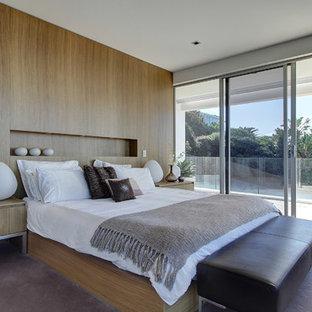 Modern inredning av ett sovrum, med heltäckningsmatta