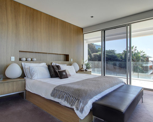 Inspiration For A Contemporary Bedroom Remodel In Sydney With Carpet