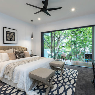 Design ideas for a contemporary master bedroom in Brisbane with white walls, carpet and grey floor.